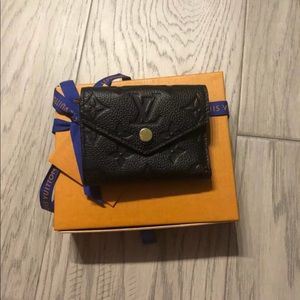 Louis Vuitton new with tags black compact wallet